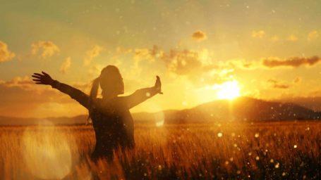 Woman embracing sunset